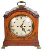A fruitwood bracket clock