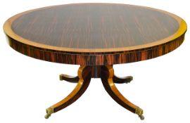 A Regency coromandel and satinwood circular centre table,