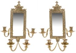 A pair of gilt brass four branch mirror back wall sconces, 20th century