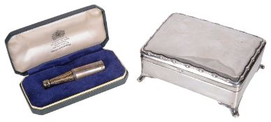 A contemporary silver trinket box and a novelty silver champagne bottle cigar piercer