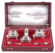 A cased three piece silver cruet suite for Harrods London, hallmarked London 1961