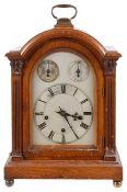A late 19th century oak cased bracket clock