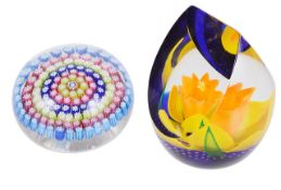 A Caithness glass paper weight and another millefiori caned paper weight,