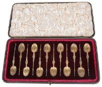 A suite of Edwardian silver gilt teaspoons, hallmarked London 1902