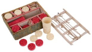 A set of late 19th century Chinese carved Canton ivory draught/backgammon counters