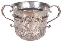 A Queen Anne Britannia silver porringer by John Cory, hallmarked London 1706