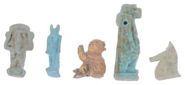 Three Egyptian turquoise glazed faience beads of figural and horse head form,