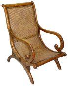 A William IV mahogany caned armchair,
