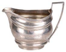 A George III silver cream jug, hallmarked London 1803,