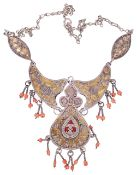 An attractive Eastern mixed metal and coral bead articulated necklace,