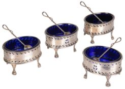 A set of four George III silver salts, hallmarked London 1783