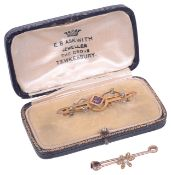 An Edwardian pearl set bar brooch and another,