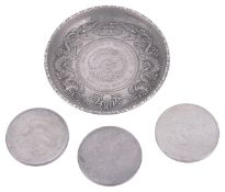 Three Chinese silver dollars and a Chinese silver dish inset with a Chinese dollar,
