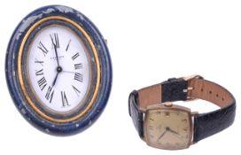 An Omega gentleman wristwatch and a Cartier travel clock