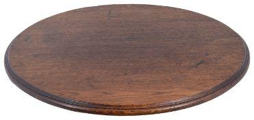 A 19th/20th century oak topped 'lazy susan'