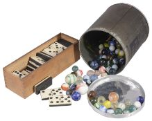 A set of bone and ebony dominoes and a collection of Victorian and later glass marbles