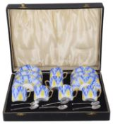 A cased Art Deco style Bohemian porcelain coffee suite with coffee spoons, 20th century