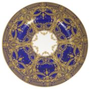 A Royal Worcester porcelain plate, the blue ground decorated with gilt hatched border and jewelled g