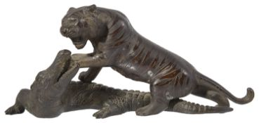 A late 19th century Japanese bronze of a tiger attacking a crocodile probably by Genryusai Seiya