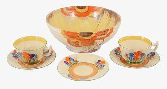 "A Clarice Cliff Bizarre ""Rodante"" pattern bowl and a part set of Bizarre ""Crocus"" pattern teacups wi"