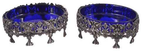 A pair of Edwardian silver salts with blue glass liners