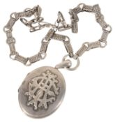 A large Victorian silver locket on fancy neck chain