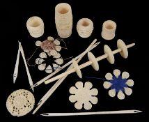 A small collection of bone and ivory sewing accessories including