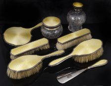 A George V silver and yellow enamel dressing table brushes, hallmarked Birmingham 1923,