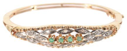 A Continental 18K gold emerald and diamond hinged bangle