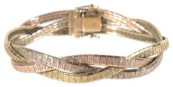 A contemporary three colour gold plaited articulated bracelet