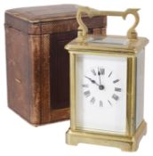 A French four glass brass carriage clock with original travel case