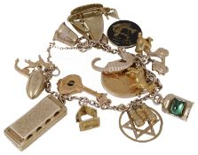 A 9ct gold and yellow metal charm bracelet hung with a variety of interesting charms