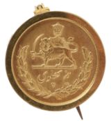 An Iranian 1/2 Pahlavi mounted gold coin