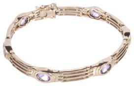 A 9ct gold articulated amethyst set gate bracelet
