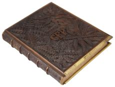 A heavily carved wooden and brass bound book by Richard Pigot entitled 'The Life of Man symbolised b