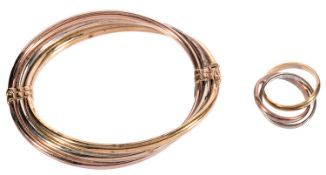 A 9ct gold three coloured triple stiff bangle