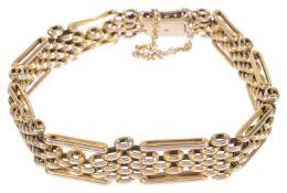 A narrow Edwardian 9ct rose gold gate bracelet
