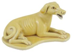A Chinese export ware yellow glazed figure of a hound
