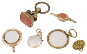 A Georgian magnifying locket, various hard stone seals and other items