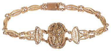 A gold Egyptian filigree 'scarab' bracelet