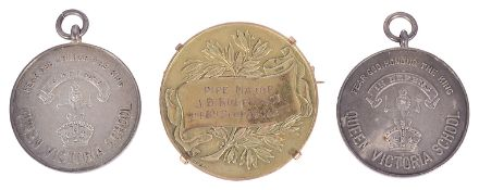 A 9ct gold piping medal awarded to Pipe Major J. B. Robertson in 1935