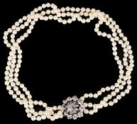 Continental cultured pearl necklace with ruby and diamond set clasp