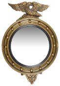 A Regency style giltwood convex circular wall mirror