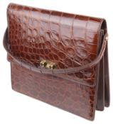 A light brown vintage ladies crocodile leather handbag