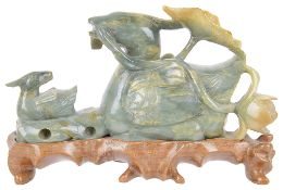 A contemporary jade carving of a duck with her duckling