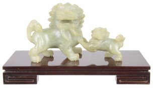 A contemporary celadon jade carving of a kyrin and young