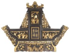 A 19th c. Chinese carved lacquered wood and gilt temple carving