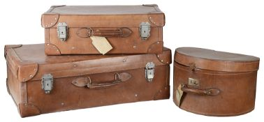A set of two Vintage leather suitcases and a matching hat box(3)