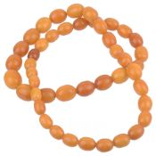 A graduated amber bead necklace