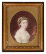 A late 19th/early 20th c. portrait miniature of a young girl on ivory